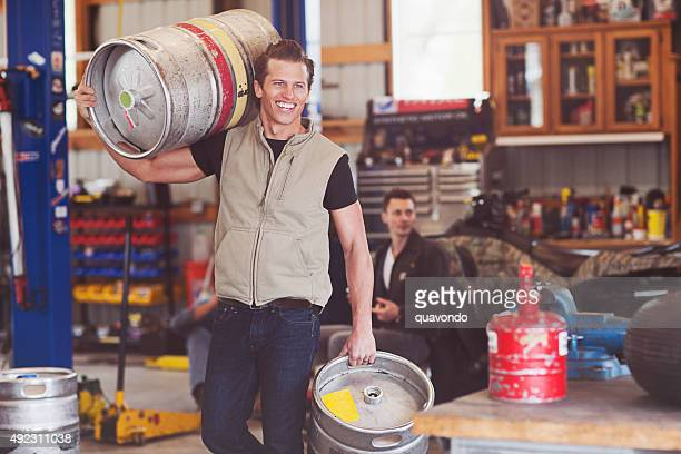 Muscular Guy Carrying Two Kegs of Beer to the Garage