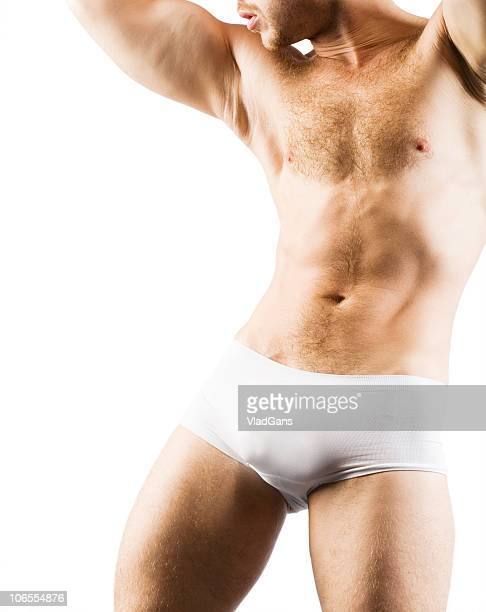 Muscular Male back in white shorts
