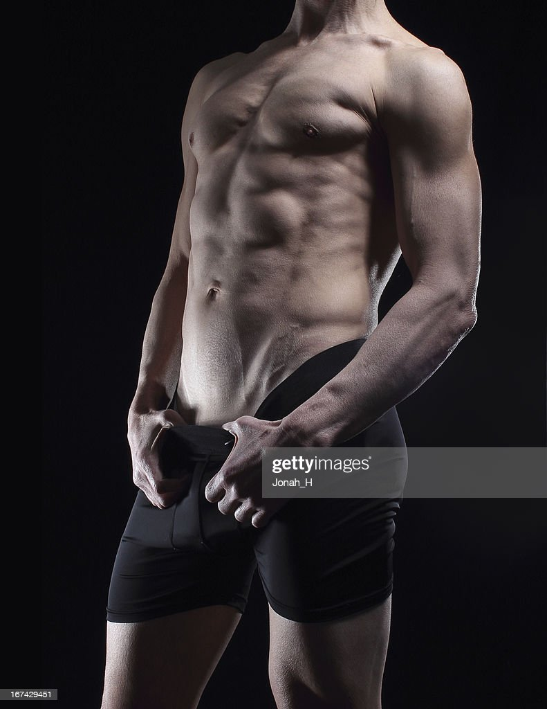 Muscular masculino Posando em roupa interior. : Foto de stock