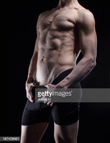 Muscular male posing in underwear. : Stock Photo