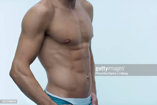 Muscular man, barechested, mid section