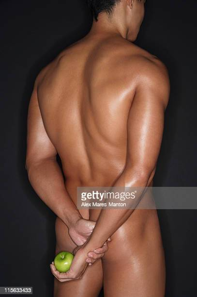 muscular man holding apple