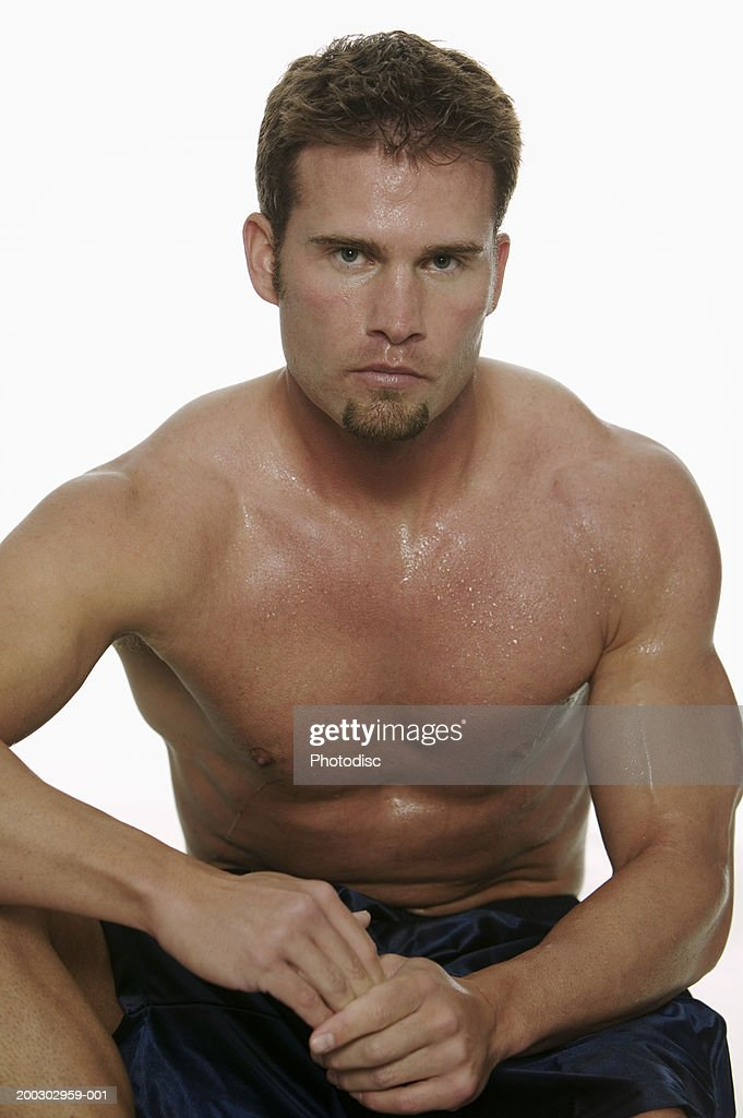 Muscular man, posing in studio, portrait : Stock Photo