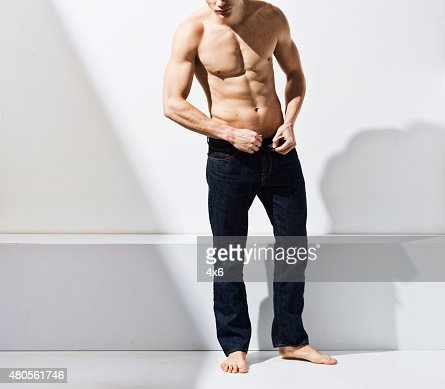 Muscular man posing : Stock Photo
