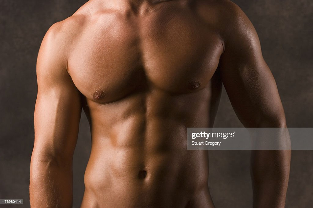 Muscular man showing chest and upper body, mid-section : Stock Photo