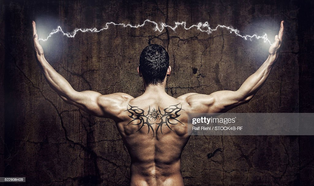 Muscular man with lightning between his hands