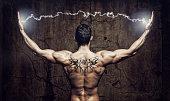 Muscular man with lightning between his hands