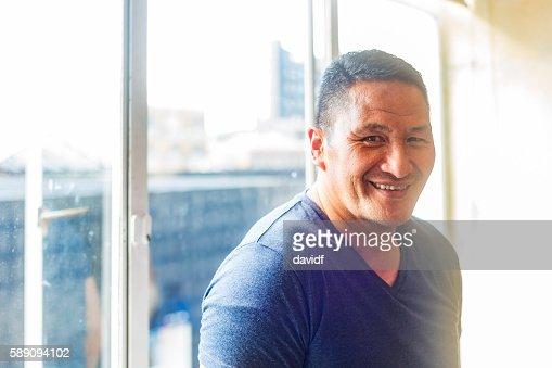 Muscular Maori Pacific Islander Man by a Window