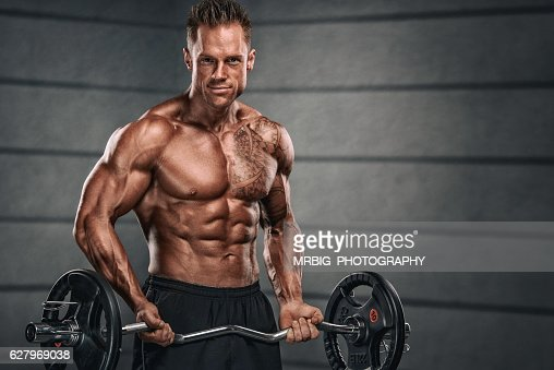 Muscular Men Exercise With Weights