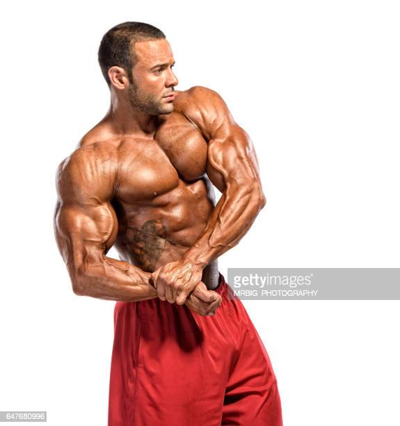Muscular Men Flexing Muscles