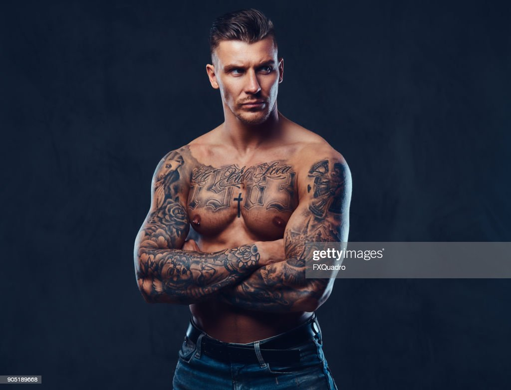 Muscled and tatted matures