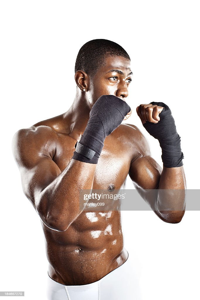 muscular young adult male boxing stance : Stock Photo