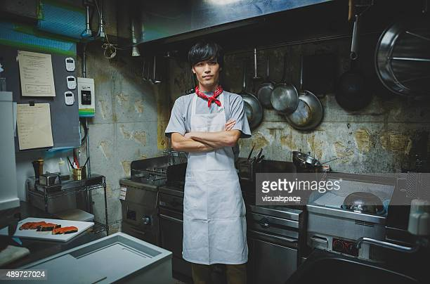 Muscular Young Asian Chef in the Kitchen