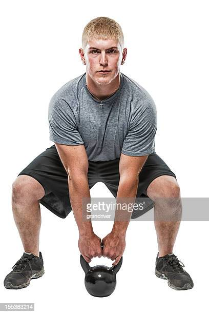 Muscular Young gym Man with Kettle Ball