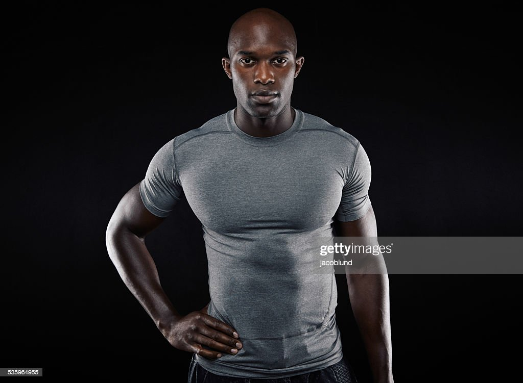 Muscular young man in sportswear : Stock Photo