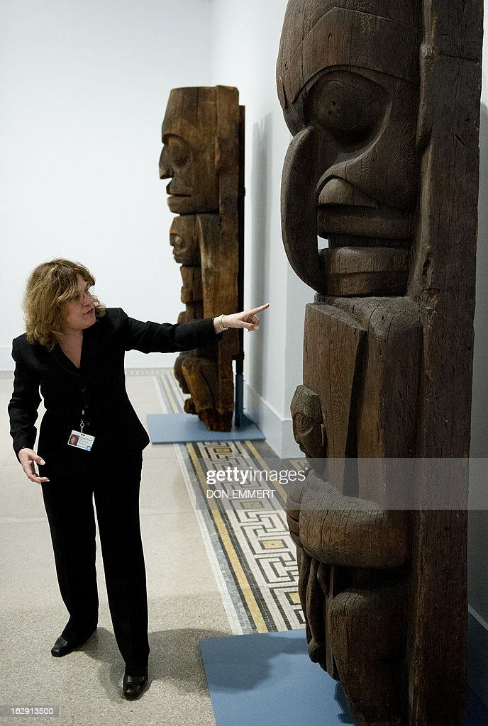Museum curator Nancy Rosoff points out features of a house post, owned by the Heiltsuk eagle clan of Yálátli (Goose Island) which is on display at the 'Life, Death, and Transformation in the Americas' exhibit at the Brooklyn Museum February 28, 2013 in New York. Themes of life, death, fertility, and regeneration are explored through pre-Columbian and historical artworks, including many pieces that are rarely on display.