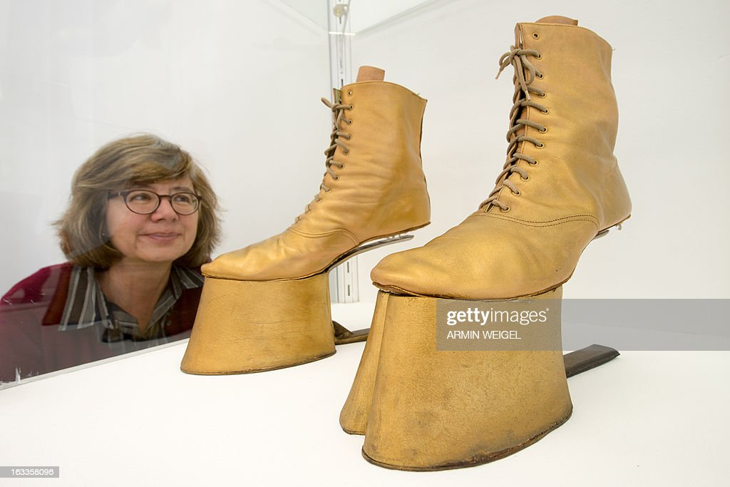 Museum employee Ulrike Schwarz looks at horse lace boots made by shoemaker Barbara Kistner for the rock opera 'Black Rider', on display at the Crafts Museum in Deggendorf, southern Germany, on March 7, 2013. The exhibition titled 'Zeigt Her Eure Schuh...' (Show Your Shoes) is running from March 10 to May 12, 2013 and displays creativity and variety of German shoemakers.