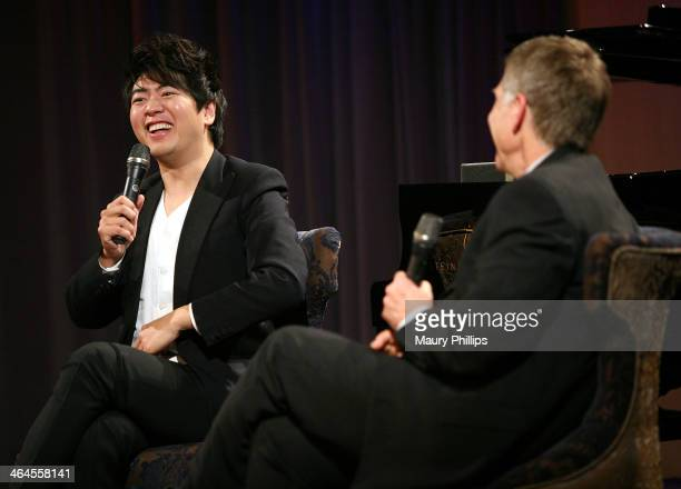 Museum executive director Bob Santelli speaks with Lang Lang during An Evening with Lang Lang at the GRAMMY Museum on January 22 2014 in Los Angeles...