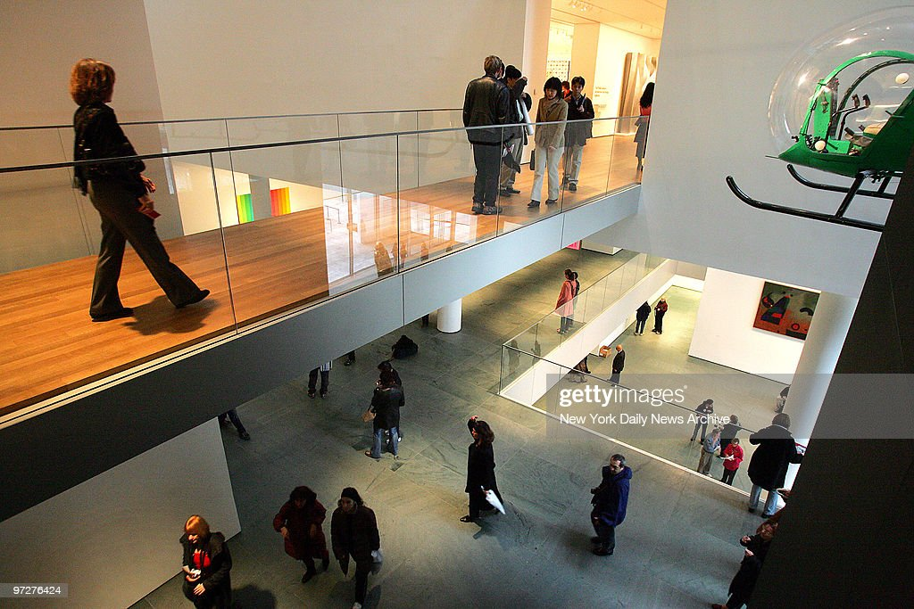 Museum goers enjoy some of the work on display at the newly renovated Museum of Modern Art which reopened on W 53rd St after being closed for two...