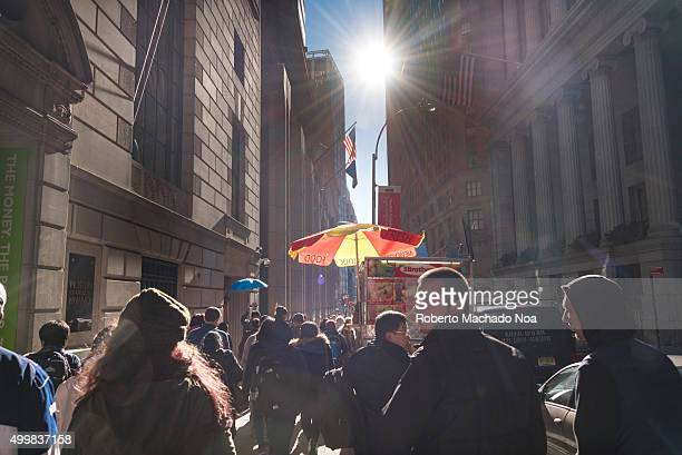 Museum of American Finance on 48 Wall street New York City People walking on a crowded street in front of the museum The Museum of American Finance...