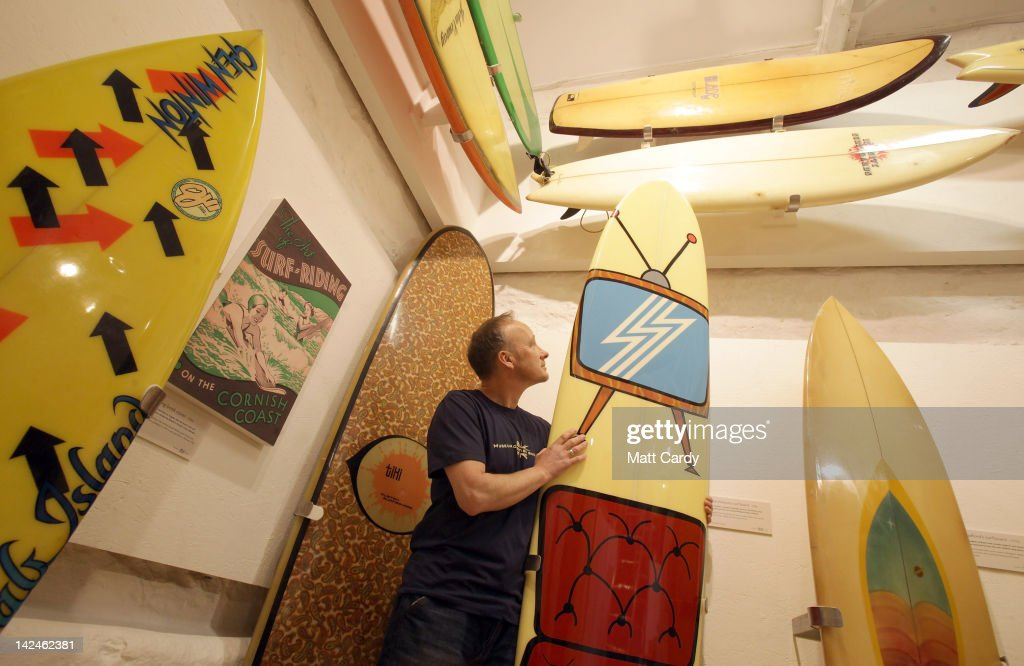 Museum of British Surfing founder Peter Robinson makes last minute adjustments to historic surfboards displayed inside the new museum on April 5, 2012 in Braunton, England. The museum, which is the first in Europe dedicated to surfing, opens to the public tomorrow. The Devon-based charity, which originally started online, holds the largest surfboard collection in Britain. As well as the collection of surfboards dating back over 100 years, the museum also holds early wetsuits, photos and other memorabilia relating to the phenomenal growth in the popularity of surfing. Surfing is now a multi-million pound industry and employs 1000s of people in the UK.