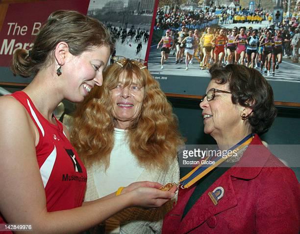 Museum of Science staff member Caroline Lowenthal of Cambridge who will run the Boston Marathon talks with the first female Boston Marathon runners...