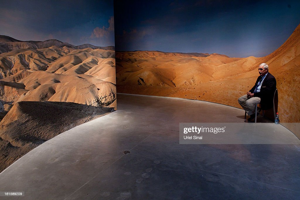 A museum security guard sits at the entrance to the 'Herod the Great' exhibition as it opens at the Israel museum on February 12, 2013 in Jerusalem, Israel. The exhibition is devoted to the architectural legacy of King Herod, the Jewish proxy monarch who ruled Jerusalem and the Holy Land under Roman occupation two millennia ago.