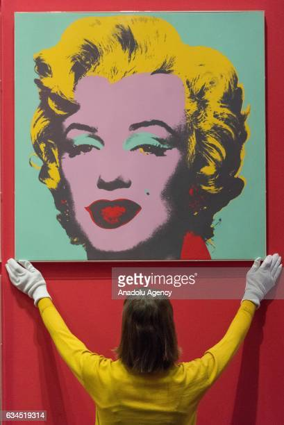 Museum staff makes final adjustments to a selection of ten colour Andy Warhol screen prints featuring Marilyn Monroe installed in the British Museums...