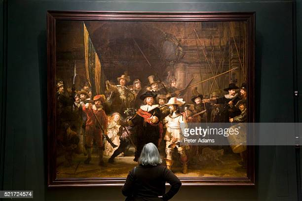 Museum Visitor Looking at Rembrandt Painting in Rijksmuseum