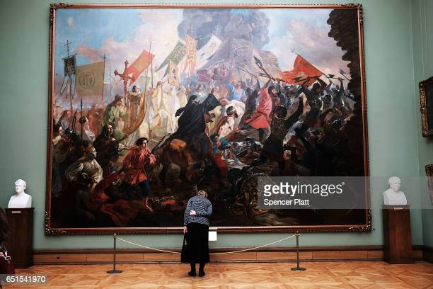 A museum visitor looks at painting The Siege of Pskov also known as the Pskov Defense in Russia at the Tretyakov Gallery in Moscow on March 10 2017...