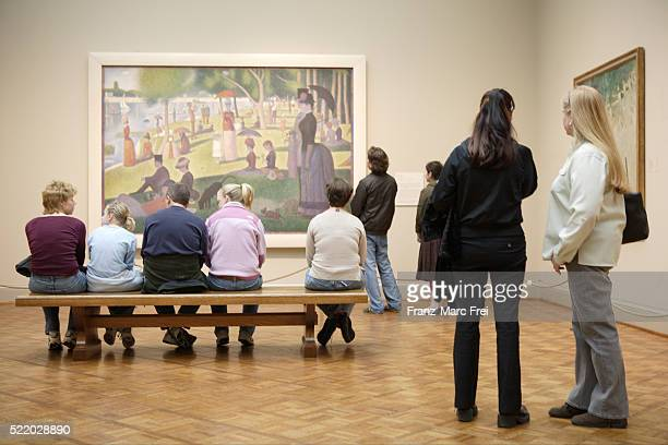 Museum Visitors Looking at Georges Seurat Painting