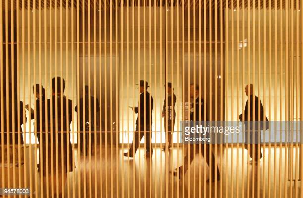 Museum visitors walk through the lobby area of the Suntory Museum of Art located at Tokyo Midtown in the Roppongi district of Tokyo Japan on Thursday...