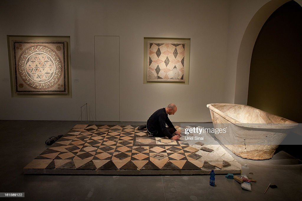 A museum worker does preparatory work before the opening of the 'Herod the Great' exhibition, at the Israel museum on February 12, 2013 in Jerusalem, Israel. The exhibition is devoted to the architectural legacy of King Herod, the Jewish proxy monarch who ruled Jerusalem and the Holy Land under Roman occupation two millennia ago.