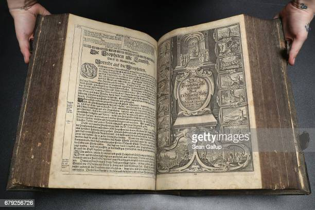 A museum worker holds a 1642 edition of Martin Luther's translation into German of the Bible in this case known as the Kurfuerstenbibel or the...