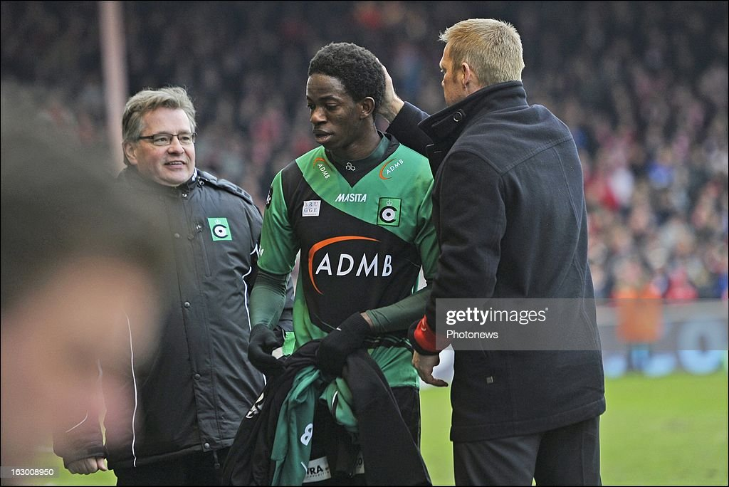 Mushaga Bakenga of Cercle Brugge and coach Foeke Booy of Cercle Brugge during the Cofidis Cup semi-final match between KV Kortrijk and Cercle Brugge in the Guldensporen stadium on March 03, 2013 in Kortrijk, Belgium.