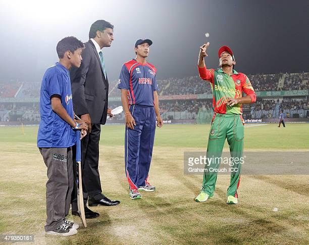 Mushfiqur Rahim captain of Bangladesh and Paras Khadka captain of Nepal at the coin toss with match referee Javagal Srinath and mascot Sadat ahead...