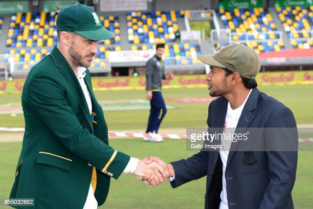 Mushfiqur Rahim of Bangladesh and Faf du Plessis of the Proteas during day 1 of the 1st Sunfoil Test match between South Africa and Bangladesh at...