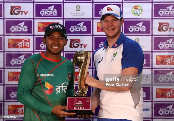 Mushfiqur Rahim of Bangladesh and Steve Smith of Australia pose with the series trophy during a press conference prior to an Australian Test team...
