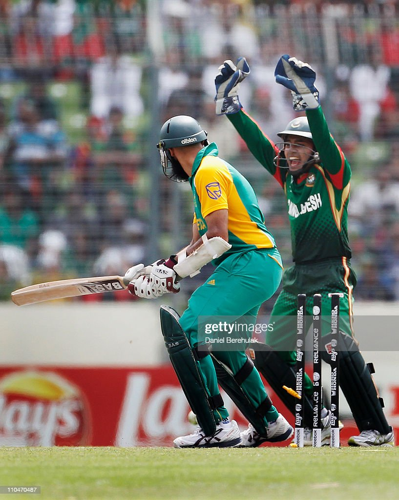 Mushfiqur Rahim of Bangladesh celebrates after Hashim Amla of South Africa is bowled by Abdur Razzak during the ICC World Cup Cricket Group B match between Bangladesh and South Africa at Shere-e-Bangla National Stadium on March 19, 2011 in Dhaka, Bangladesh.