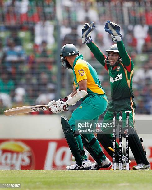 Mushfiqur Rahim of Bangladesh celebrates after Hashim Amla of South Africa is bowled by Abdur Razzak during the ICC World Cup Cricket Group B match...