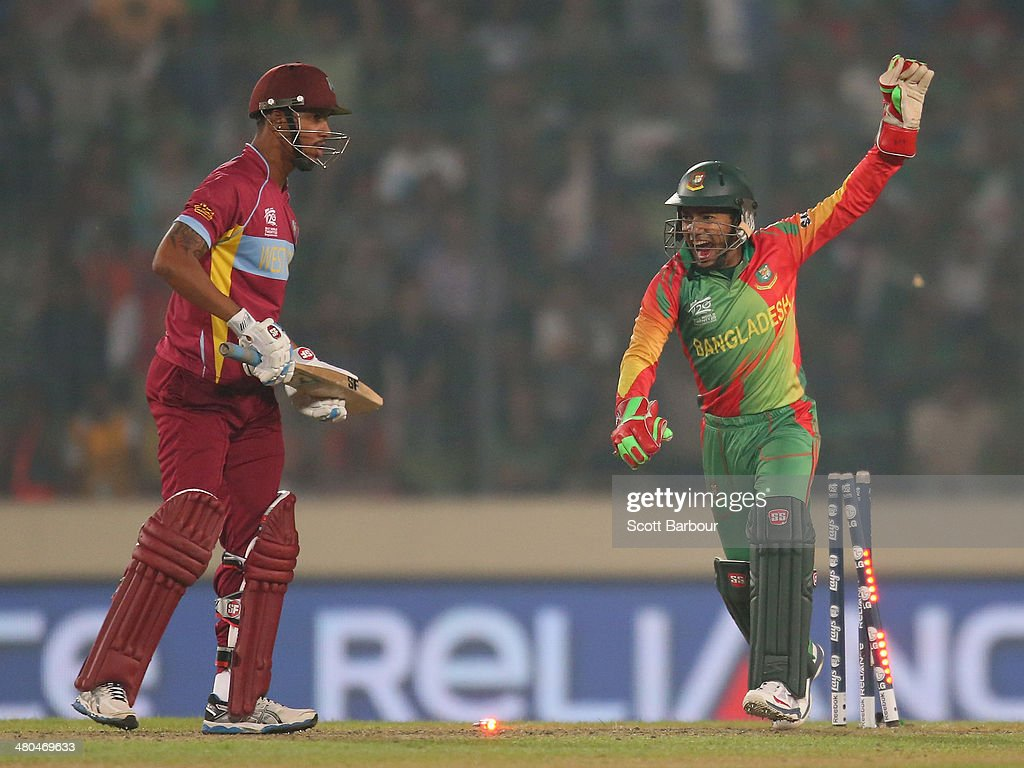 Mushfiqur Rahim of Bangladesh celebrates as he stumps Lendl Simmons of the West Indies during the ICC World Twenty20 Bangladesh 2014 match between Bangladesh and the West Indies at Sher-e-Bangla Mirpur Stadium on March 25, 2014 in Dhaka, Bangladesh.