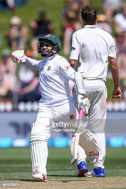 Mushfiqur Rahim of Bangladesh celebrates his century during day two of the First Test match between New Zealand and Bangladesh at Basin Reserve on...