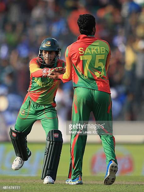 Mushfiqur Rahim of Bangladesh celebrates the wicket of aib Malik of Pakistan after he was stumped off the bowling of Shakib Al Hasan during the ICC...