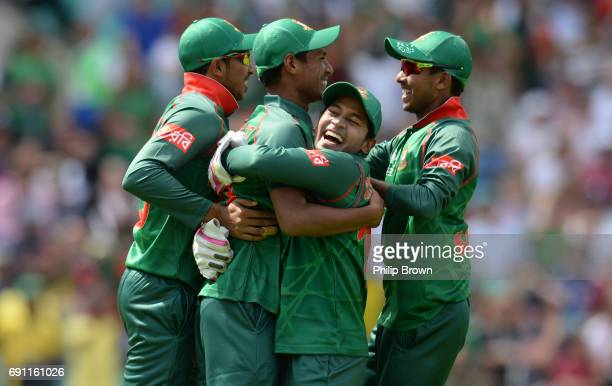 Mushfiqur Rahim of Bangladesh celebrates with teammates after the dismissal of Jason Roy of England during the ICC Champions Trophy match between...