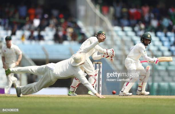 Mushfiqur Rahim of Bangladesh edges a shot past Steve Smith of Australia during day one of the Second Test match between Bangladesh and Australia at...
