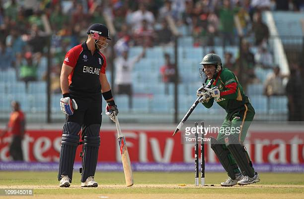 Mushfiqur Rahim of Bangladesh stumps Matt Prior of England by removing the stump after intially stumping him during the 2011 ICC World Cup Group B...