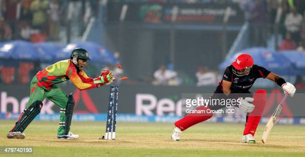 Mushfiqur Rahim of Bangladesh stumps Munir Dar of Hong Kong during the Bangladesh v Hong Kong match at the ICC World Twenty20 Bangladesh 2014 played...