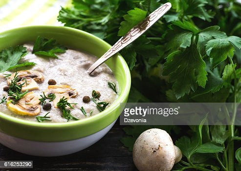 Mushroom puree soup with allspice, parsley, champignons and toas : Stock Photo