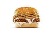 High resolution, digital capture of a Swiss cheese and mushroom cheeseburger with mushrooms, mushroom sauce, Swiss cheese, and fresh ground beef, on a fresh sesame seed bun, set against a clean, white