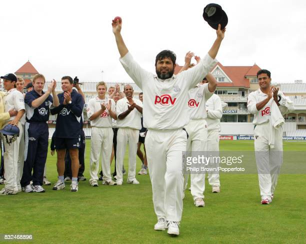Mushtaq Ahmed of Sussex celebrates after Sussex secured the Liverpool Victoria County Championship by winning the County Championship match between...